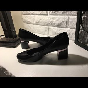 Black pumps with silver accents. Gently worn.